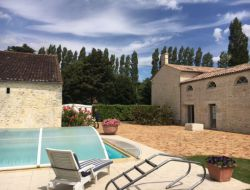 Holiday rental with pool near La Rochelle in France. near Saint Saturnin du Bois